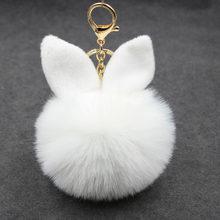 Novo coelho fofo brinquedos orelha chaveiro coelho pele mulher saco encantos chaveiro pom pom pompom pingente de carro titular jóias(China)