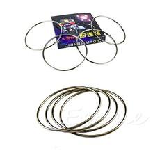 Il trasporto libero 4 magia cinese linking rings set serratura magnetica bambini festa spettacolo teatrale trucco(China (Mainland))