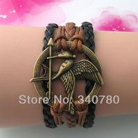 Hot new The Hunger Games bronze Eros sword charm bracelet hand-knitted leather cords multi-layer birds animal bracelet FB102