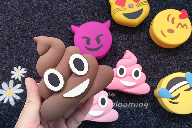 Cartoon character expression rubber poop phone charging treasure universal emergency mobile power charger 8000 mA Universal