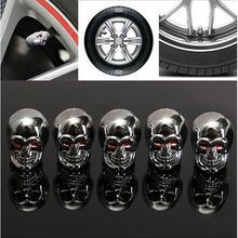 2016 Hot Sale Red Eyes Evil Skull Tyre Air Valve Stem Dust Caps For Car Truck Bike Top Free Shipping(China (Mainland))