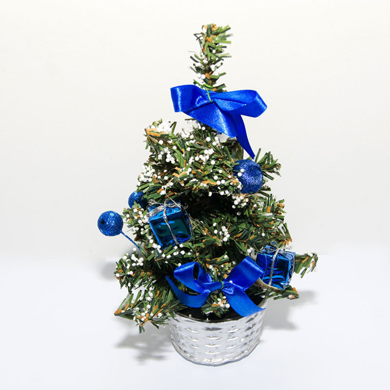 add the dash of style and contemporariness to your holiday decor by adorning your small christmas tree with blue ornaments and bows