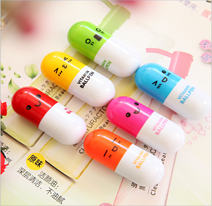Specials, free shipping 2015 Cute Smiling Face Pill Ball Point Pen Pencils Telescopic Vitamin Capsule Ballpen for School 0601