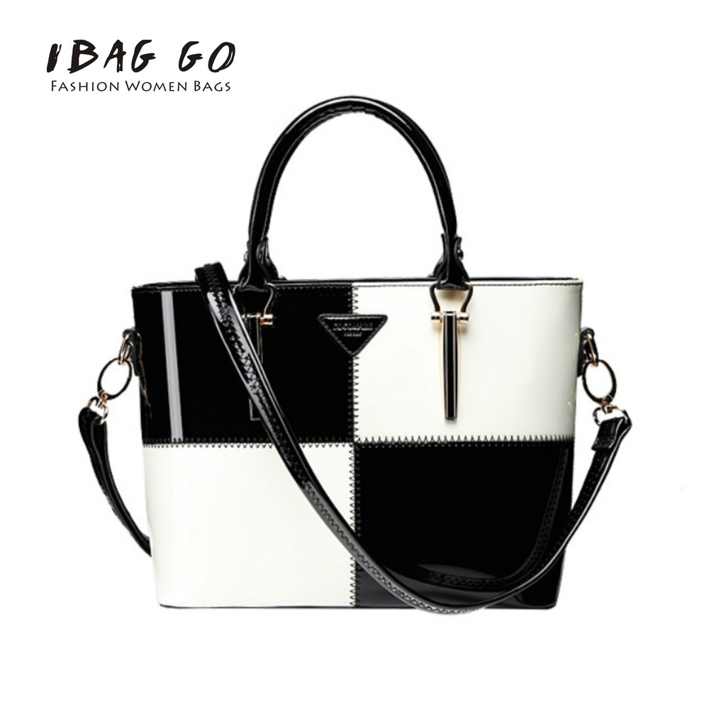 Commuter Bag 2015 New Spring And Summer Hit The Color Black And White Patent Leather Handbags Popular Messenger Bag(China (Mainland))