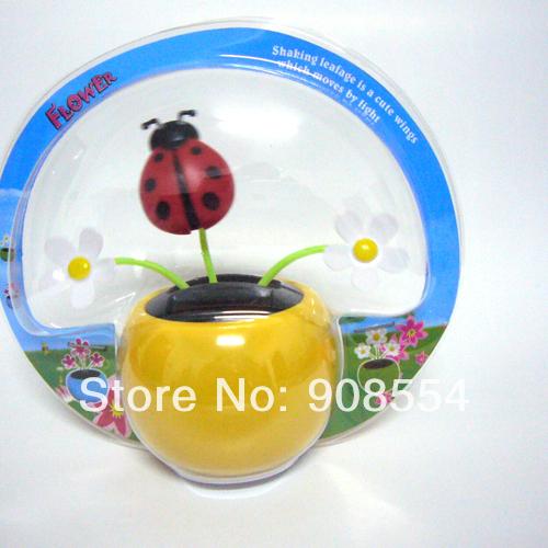 The Wholesale Price 12 Pcs Per Lot Magic Cute Three Flowers Flip Flap Lady Bug Car Decoration Solar Dancing Novelty Toy(China (Mainland))
