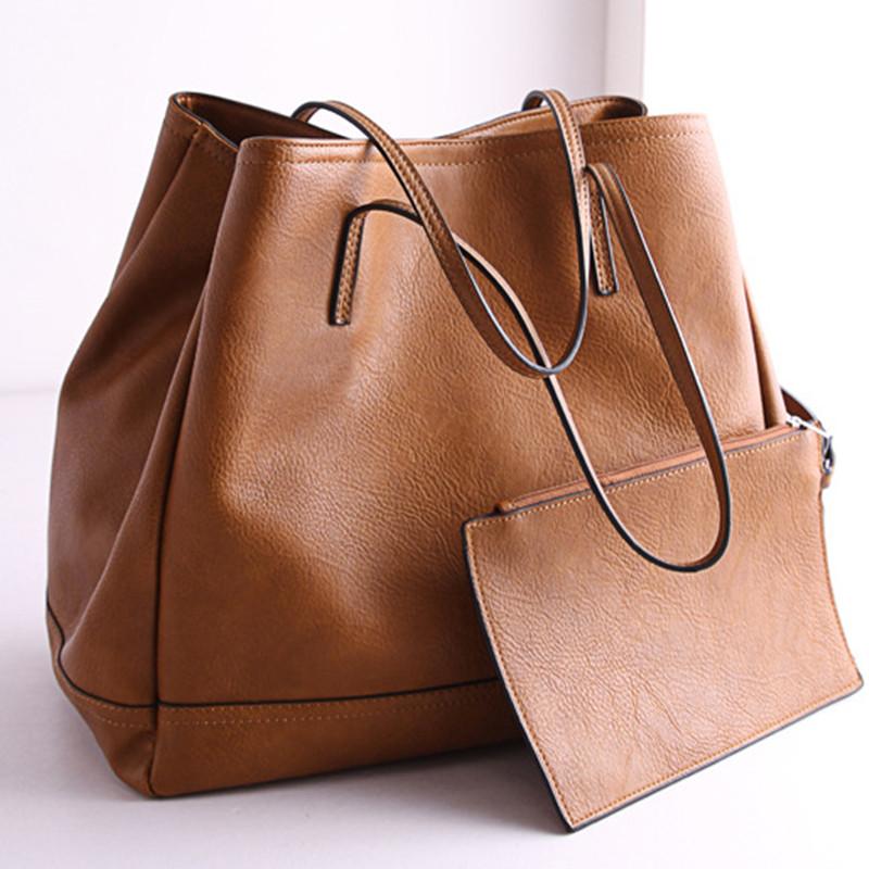Fashion OEM Small(20-30cm) Soft Solid Genuine Leather Casual Tote Handbag Smiley Type Bat Single Bag Interior Zipper Pocket 2016(China (Mainland))