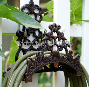 Vintage wall mounted hose holder cast iron hose hanger for Rustic home decor suppliers