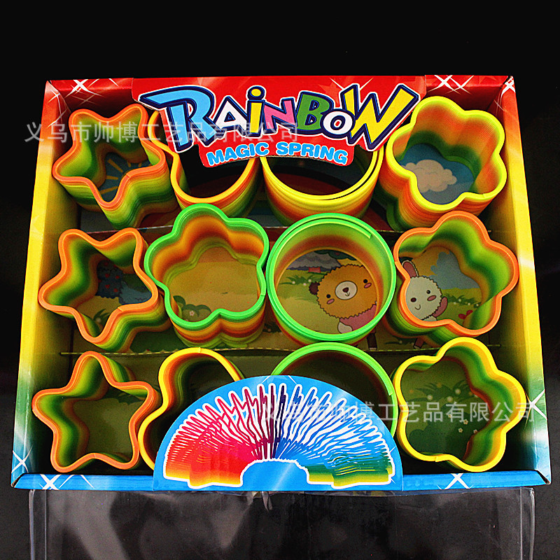 12Pcs Magic Plastic Rainbow Spring Toy Stretchy Rainbow Circle baby early learning puzzle educational toy Free shipping #18460(China (Mainland))