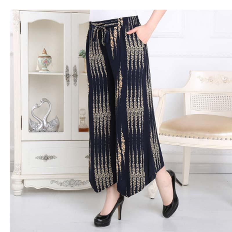 2016 summer quinquagenarian length trousers flower fluid wide leg pants culottes plus size high waist pants Print Loose AE1016(China (Mainland))