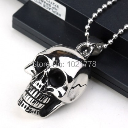 Free shipping Europe and the United States large skull black drop of oil titanium steel pendants necklace jewelry(China (Mainland))