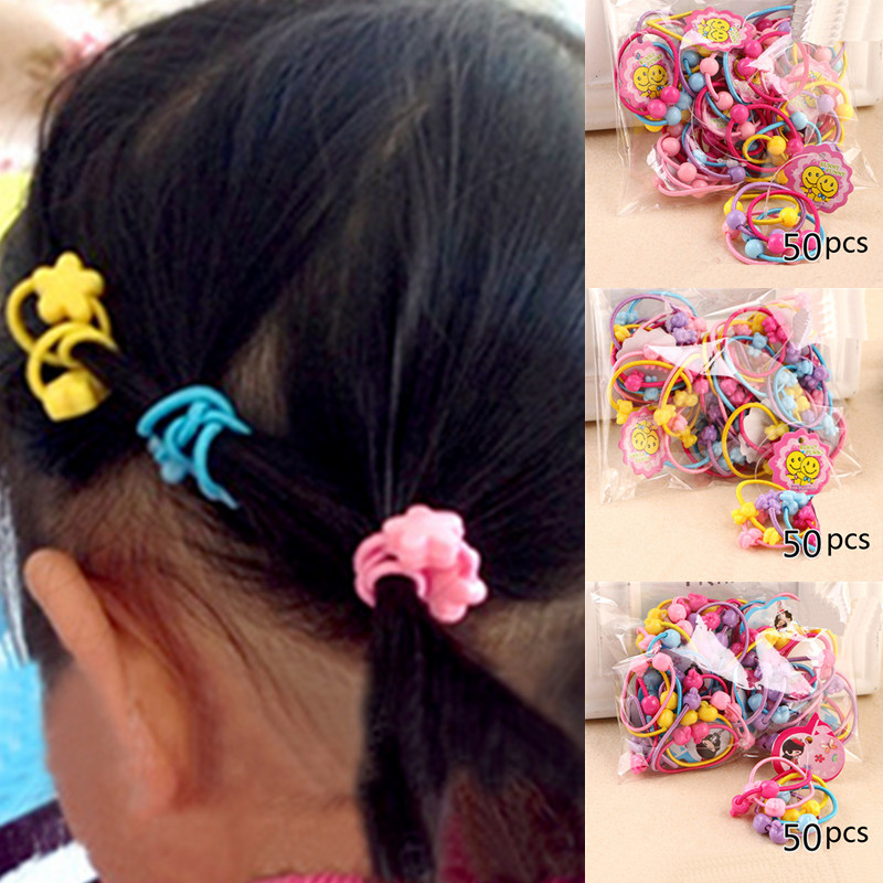 50pcs/Pack 2016 Cute Elastic Hair Bands Kids Hair Ties Baby Rubber Band Headdress Girls Hair Accessories(China (Mainland))