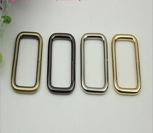 Free shipping (30 PCS/lot) 38 * 20 mm metal accessories DIY bag button hoop party link square square coil(China (Mainland))