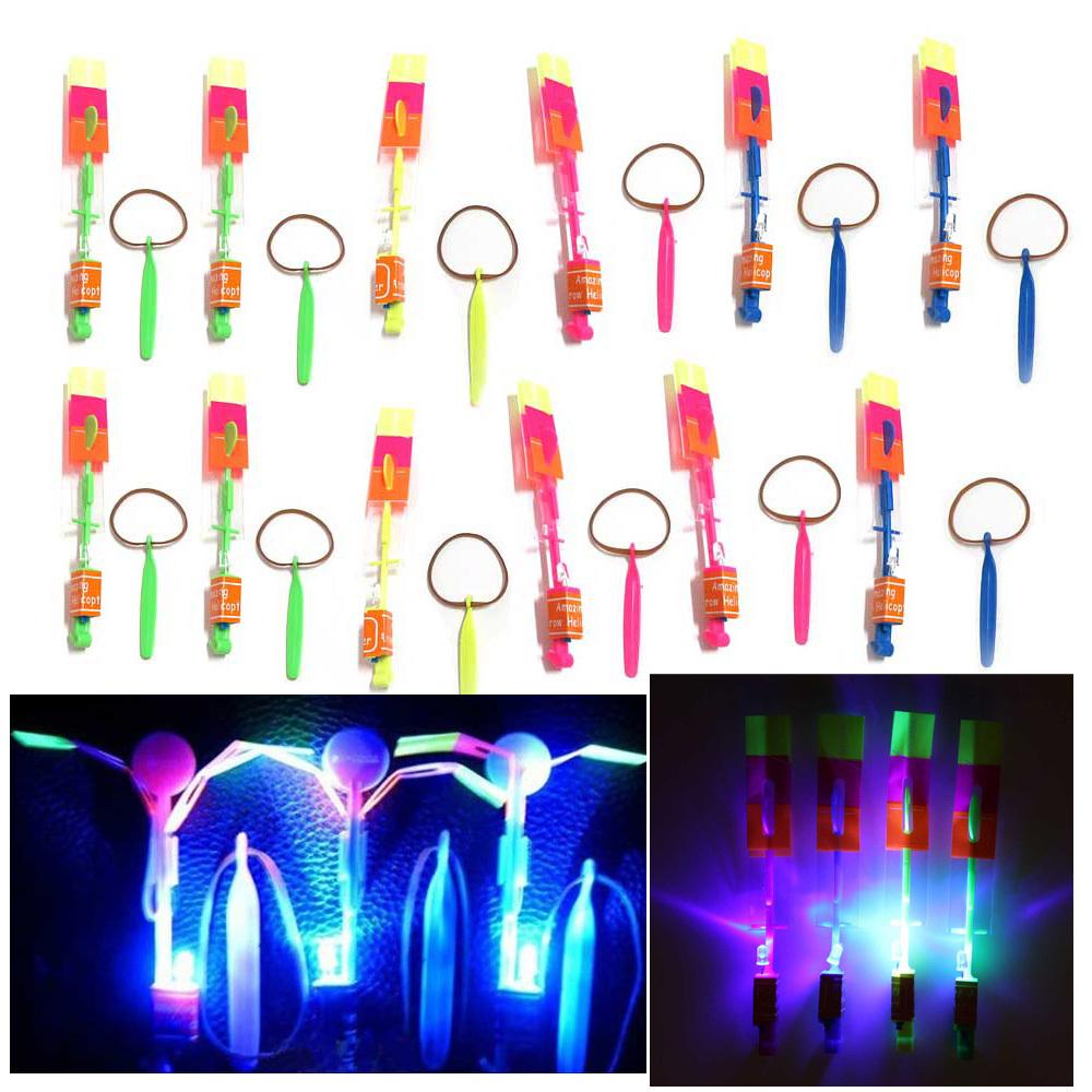 50Pcs Amazing LED Light Arrow Rocket Helicopter Flying Toy Party Fun Gift Free Shipping K5BO(China (Mainland))