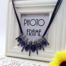 Min. order $10 . Free shipping! Imitation blue diomands rhinestone gem crystal peacock feather rope statement necklace fashion(China (Mainland))