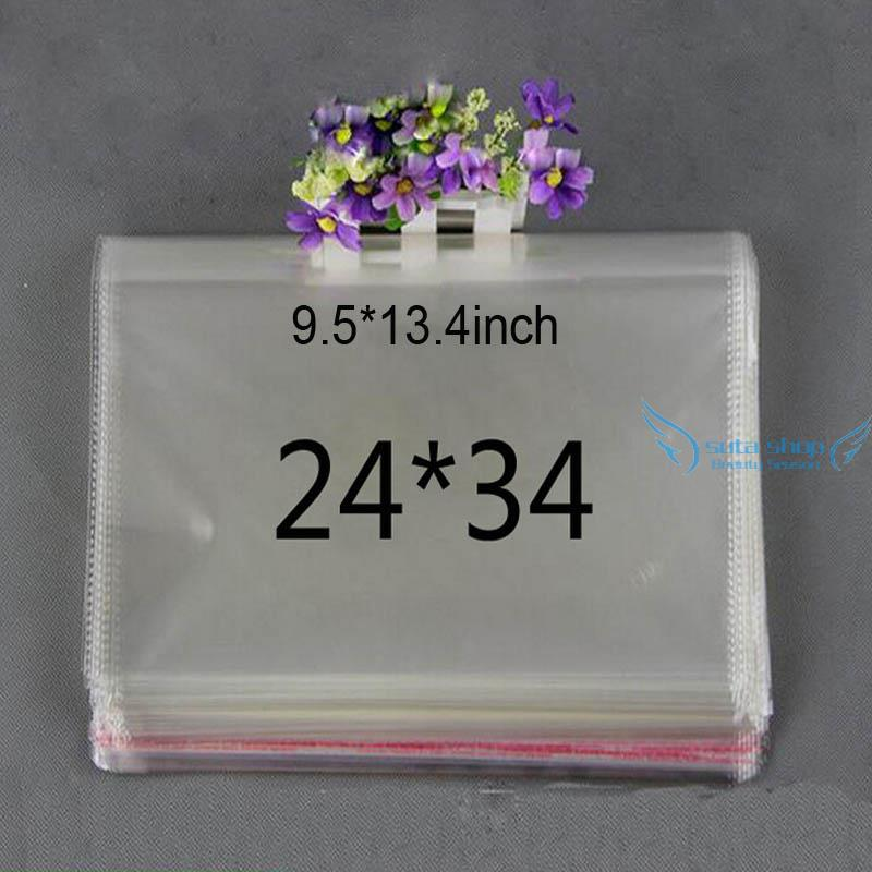 100pcs/lot 9.5*13.4inch Clear plastic bags Apparel Clothing packaging Self Adhesive Seal OPP Package bag transparent Wholesale(China (Mainland))
