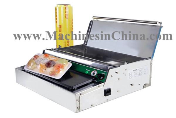 Vacuum sealing machine Plastic Wrap Packaging Machine Food Cling Film Machine(China (Mainland))