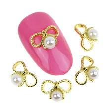 10Pcs/Lot New Gold Alloy Bowknot Nail Charms 3D Pearls Nail Art Supplies Nails Jewelry Accessories For Women Decoration MA0638(China (Mainland))