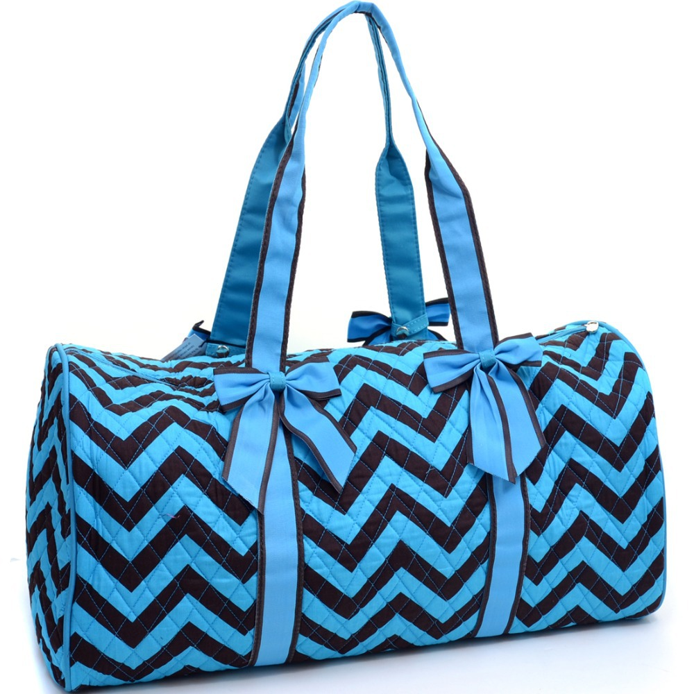 blue large quilted duffle bag with bow decor in