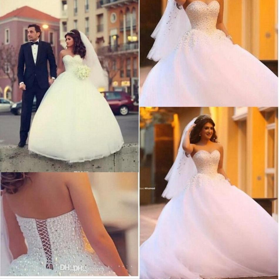 Свадебные платья с жемчугом на корсете