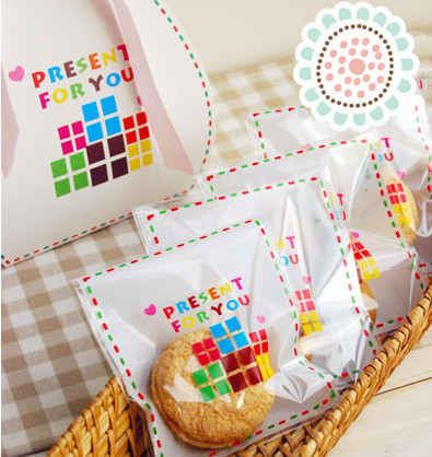 """100pcs/lot """"present for you"""" plastic packaging bags cookie packaging bags 10x11cm gift bag free shipping(China (Mainland))"""