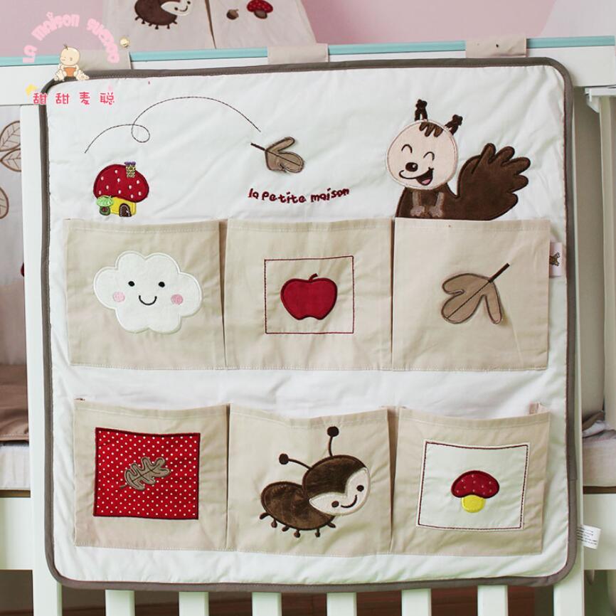 Cartoon Baby Bed Organizer Crib Storage Hanging Bag Diaper Toys Pockets Bedding Set Free Shipping<br><br>Aliexpress