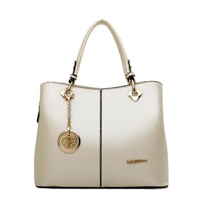 Graceful lady handbags,Beige pendant mother's bag,simple vertical type shoulder bags,US OL purses,female makeup bags,borse donna(China (Mainland))