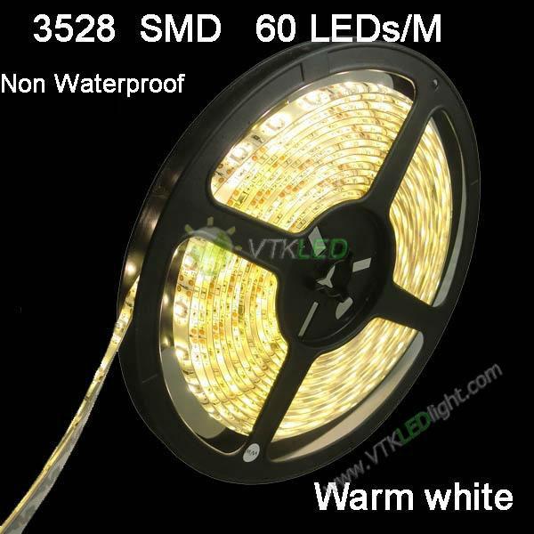 hot free shipping warm white 3528 led strip 300led 5m/roll, 3528 LED Strip 60leds SMD Warm White Flexible LED Ribbon Light 12V(China (Mainland))