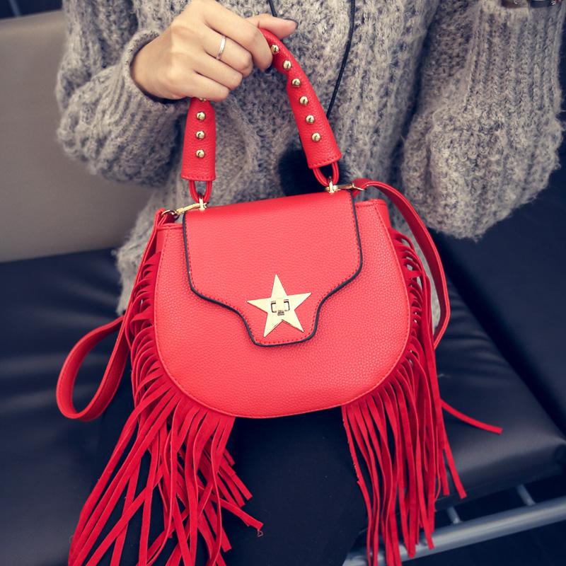 sweet lady tassel Saddle Bag Fashion rivet lock Shoulder handbag personality small pu leather Crossbody Bag