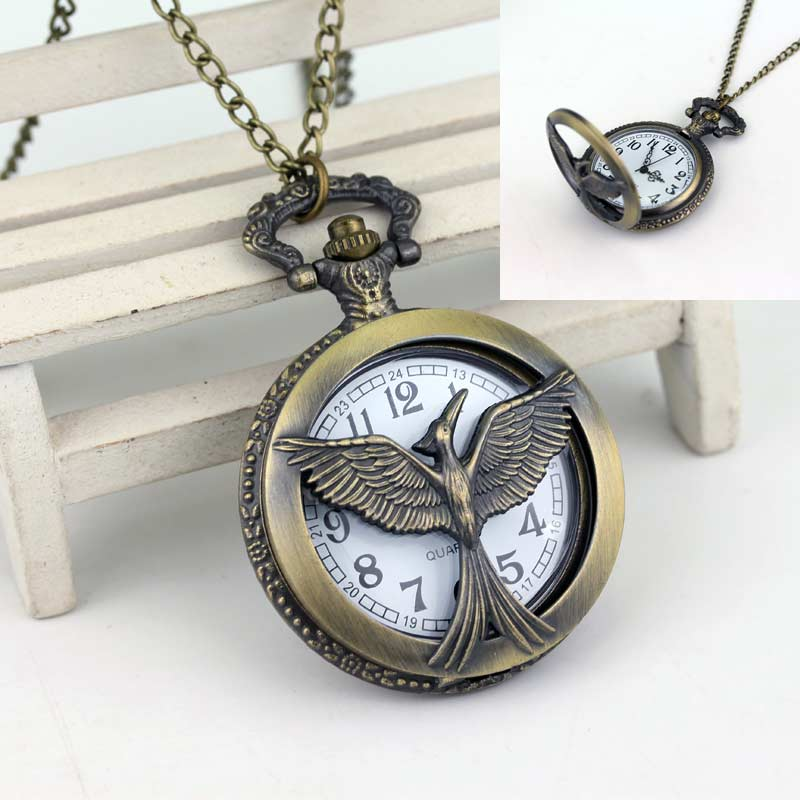 Free Shipping Fashion Bronze Retro Vintage Hunger Games Bird Quartz Pocket Watch Round Dial Gifts For Family Movie Jewelry(China (Mainland))