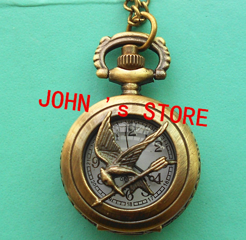 Freeshipping wholesale 20pcs/lot  mix diff styles hunger games  pocket watches  Dia27mm S494<br><br>Aliexpress
