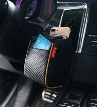 Bolsa de vehículo digitales remax original de alta calidad de fibra de carbono universal de marca de teléfono móvil y una variedad de objetos pequeños(China (Mainland))