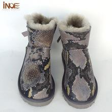 2015 de La Moda de piel de Oveja de cuero forrada de piel corto chicas bowknot botas de nieve del tobillo para las mujeres zapatos de invierno impermeable envío libre(China (Mainland))