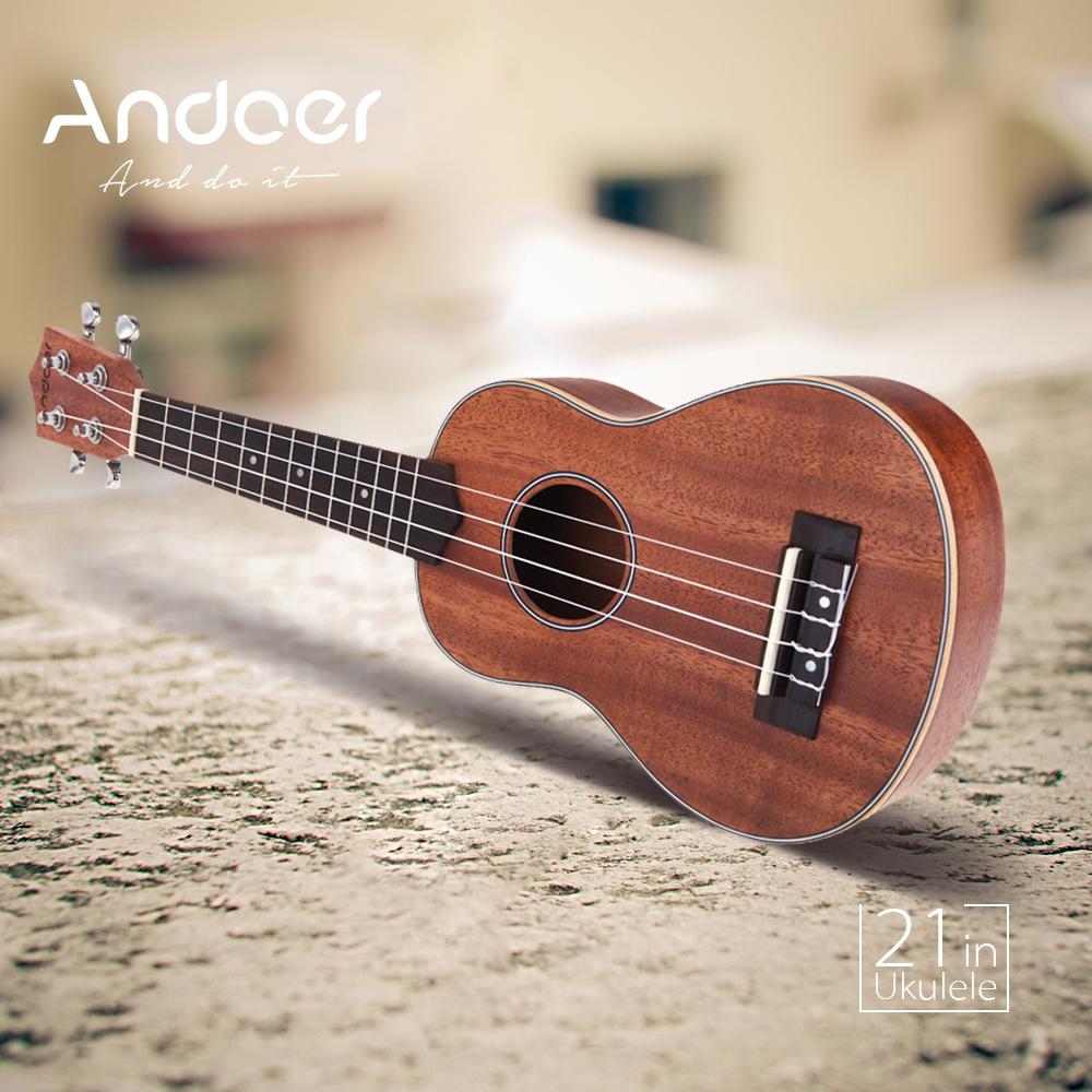 Andoer 21'' Compact Ukelele Ukulele Hawaiian Guitar Mahogany Aquila Rosewood Fretboard Bridge Soprano Stringed Instrument(China (Mainland))