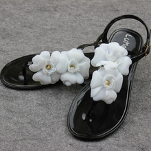 Free shipping small fragrant summer flowers Camellia Crystal beach flip flip clip toe flat shoes jelly shoes sandals slip(China (Mainland))