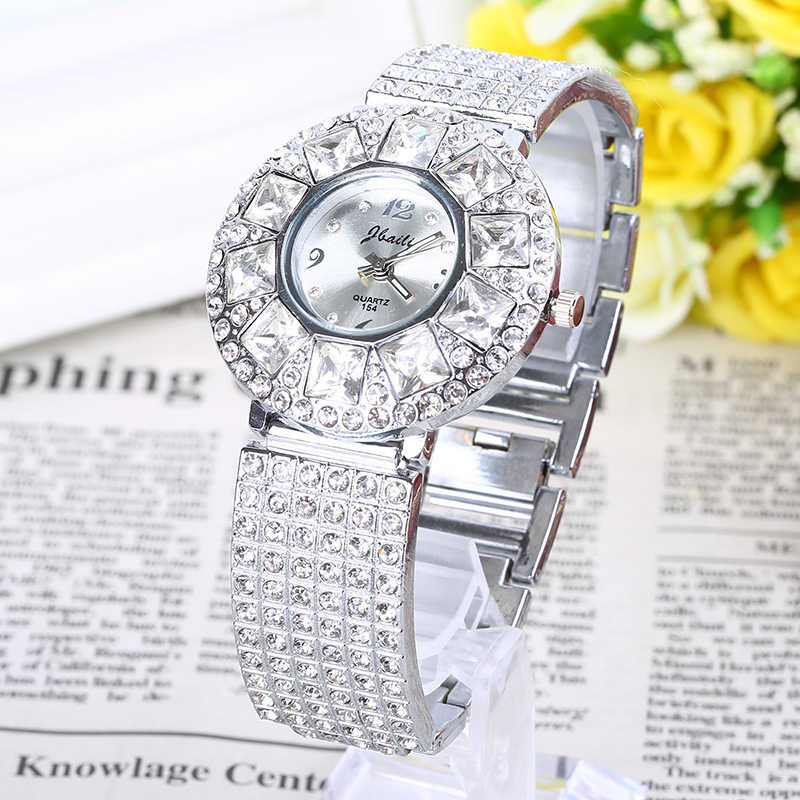 2016 Direct Selling Real Women Hardlex High Fashion Ladies Watch Personality Alloy Quartz Imported Metal Table Female Movement(China (Mainland))