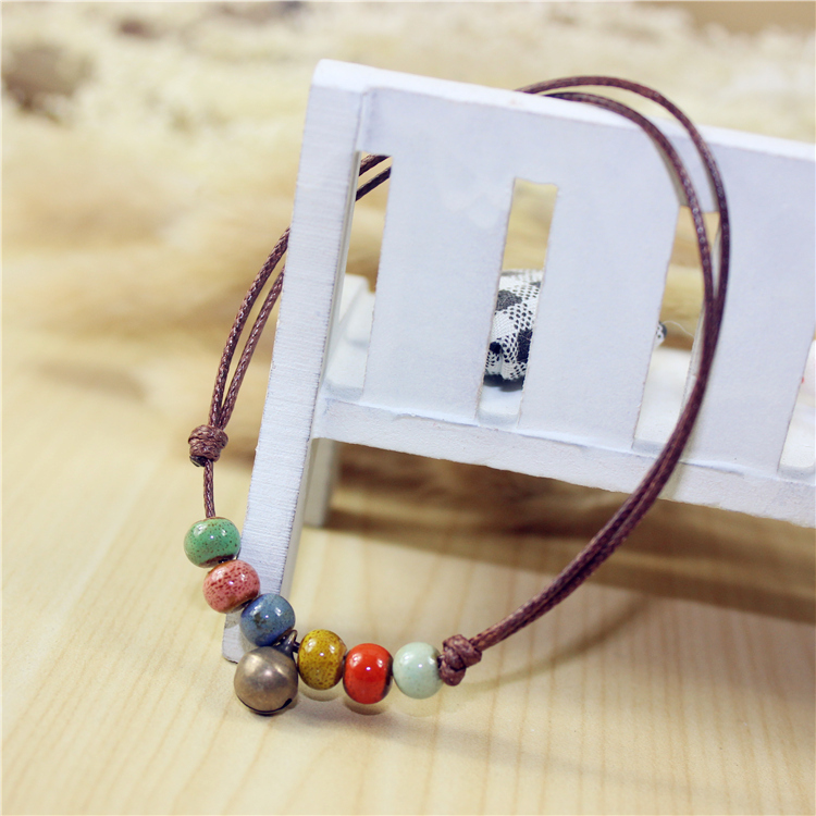 Hot sale leather cord girls ceramic stone bead bracelet rope chain simple design lovely Bohemia style fashion jewelry for women(China (Mainland))