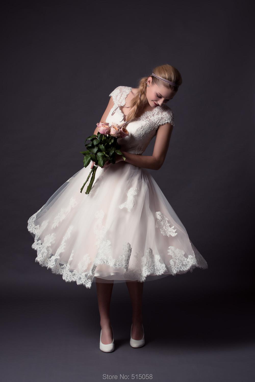 New elegant lace short sleeves tea length wedding dresses for Elegant tea length wedding dresses