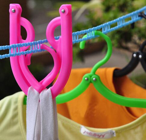 1PCS Portable Folding Plastic Clothing Coat Hanger Travel Foldable Hanger(China (Mainland))