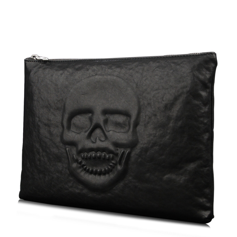 The new skull hand bag Cowhide leather male baotou layer hand caught the handbag envelope bag<br>