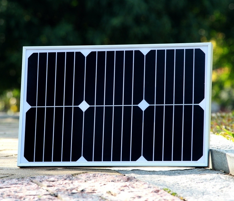18W glass laminated solar module with high efficiency USA High efficiency solar cell for charging 12V battery(China (Mainland))