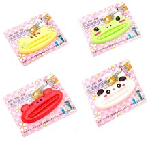 Free shipping, hot fashion toothpaste squeezer, slit length 6.3cm, 10 pieces 1 lot, 4 designs, IY0003(China (Mainland))