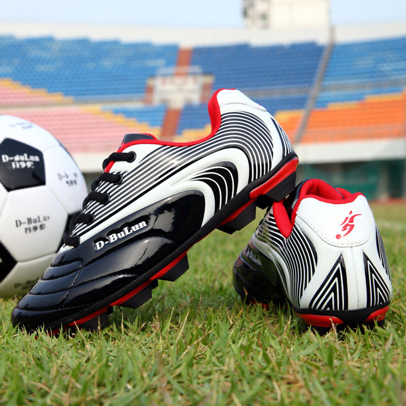 High quality HARD GROUND football shoes, professional leather foot training football shoes, champion soccer shoes,(China (Mainland))