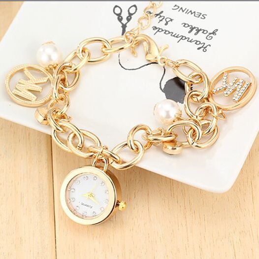 Гаджет  New decorative bracelet watches, 2015 of the latest fashion lady watches,circular dial, pearl decoration,noble lady