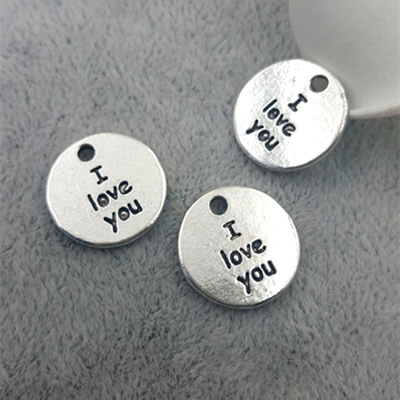 High Quality 10 Pieces/Lot Diameter 15mm Antique Silver Plated Letter Printed I love You Small Tag Love Charms(China (Mainland))