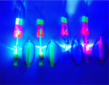 Hot sale 12Pcs Amazing LED Light Arrow Rocket Helicopter Flying Toy LED Light Flash Toys baby Toys Party Fun Gift Xmas(China (Mainland))