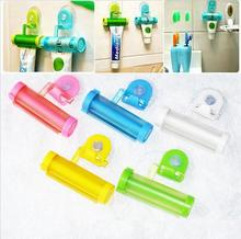 Plastic Rolling Tube Squeezer Useful Toothpaste Easy Dispenser Bathroom Holder Free Shipping