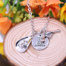 The Walking Dead Necklace With Gun Hat and Tag Charms