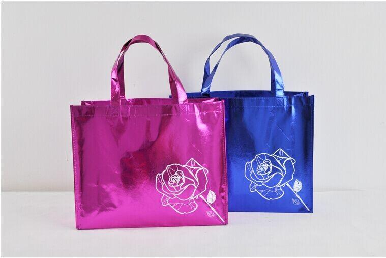 wholesales 500pcs/lot 30Hx40x10cm Laser Laminated Beautiful Garment Non woven Bags with Customized Printing Company Brand Logo(China (Mainland))