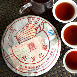 B00299 Free Shipping Peacocks Home Old tea trees Cake Yunnan Seven Cakes Puer Tea 2012yr Cooked