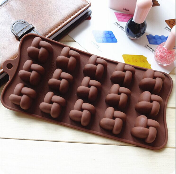 Free Shipping DIY Food-grade Siliconee Chocolate Mold Chinese Knot Style Mold Soap Mold Kitchen Tool 22*10*1.3cm(China (Mainland))